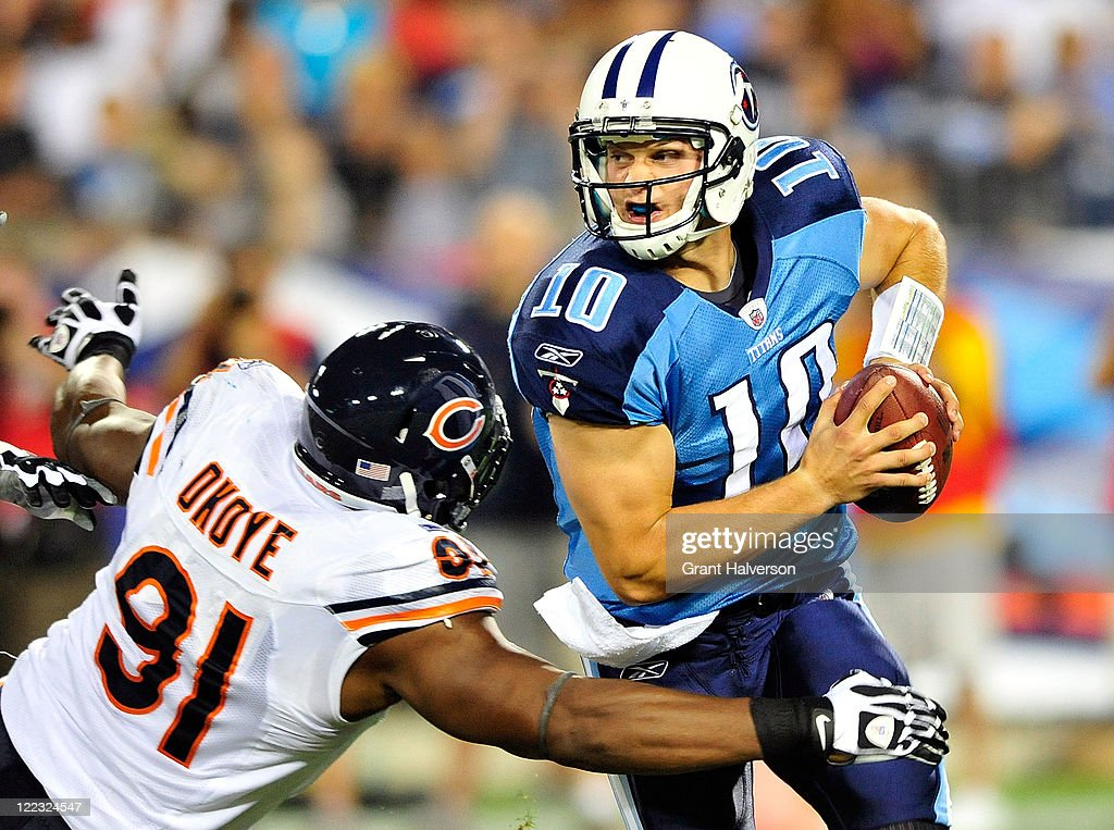 <a gi-track='captionPersonalityLinkClicked' href=/galleries/search?phrase=Jake+Locker&family=editorial&specificpeople=4450185 ng-click='$event.stopPropagation()'>Jake Locker</a> #10 of the Tennessee Titans is sacked by <a gi-track='captionPersonalityLinkClicked' href=/galleries/search?phrase=Amobi+Okoye&family=editorial&specificpeople=2285401 ng-click='$event.stopPropagation()'>Amobi Okoye</a> #91 of the Chicago Bears during a preseason game at LP Field on August 27, 2011 in Nashville, Tennessee. Tennessee defeated Chicago, 14-13.