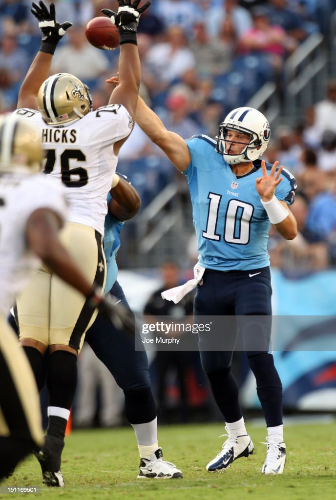 <a gi-track='captionPersonalityLinkClicked' href=/galleries/search?phrase=Jake+Locker&family=editorial&specificpeople=4450185 ng-click='$event.stopPropagation()'>Jake Locker</a> #10 of the Tennessee Titans passes against Akiem Hicks #76 of the New Orleans Saints at LP Field on August 30, 2012 in Nashville, Tennessee.