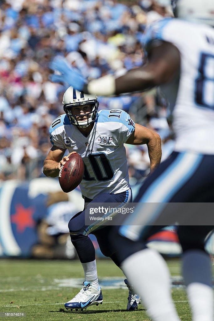 <a gi-track='captionPersonalityLinkClicked' href=/galleries/search?phrase=Jake+Locker&family=editorial&specificpeople=4450185 ng-click='$event.stopPropagation()'>Jake Locker</a> #10 of the Tennessee Titans rolls out of the pocket and looks downfield for a receiver against the San Diego Chargers at LP Field on September 22, 2013 in Nashville, Tennessee. The Titans defeated the Chargers 20-17.