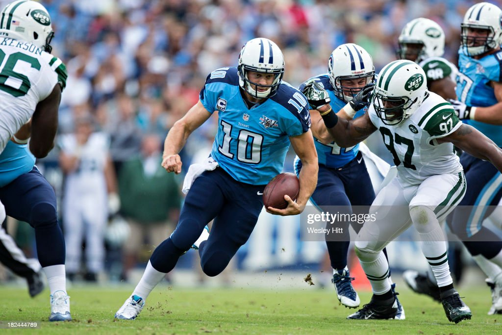 <a gi-track='captionPersonalityLinkClicked' href=/galleries/search?phrase=Jake+Locker&family=editorial&specificpeople=4450185 ng-click='$event.stopPropagation()'>Jake Locker</a> #10 of the Tennessee Titans runs the ball against the New York Jets at LP Field on September 29, 2013 in Nashville, Tennessee. The Titans defeated the Jets 38-13.