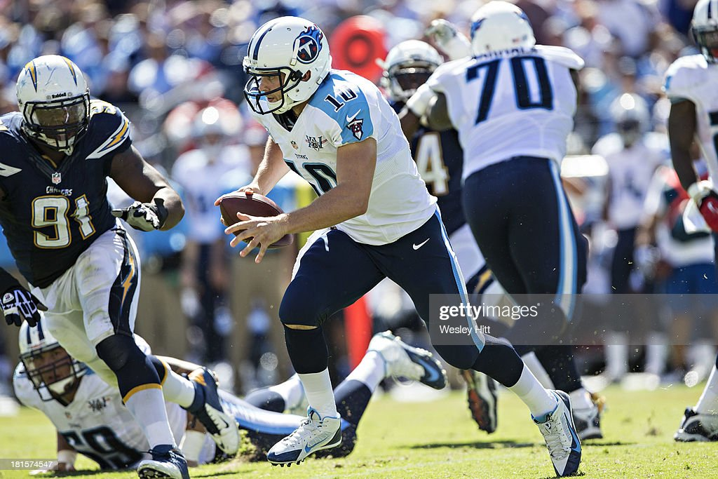 <a gi-track='captionPersonalityLinkClicked' href=/galleries/search?phrase=Jake+Locker&family=editorial&specificpeople=4450185 ng-click='$event.stopPropagation()'>Jake Locker</a> #10 of the Tennessee Titans runs the ball against the San Diego Chargers at LP Field on September 22, 2013 in Nashville, Tennessee. The Titans defeated the Chargers 20-17.