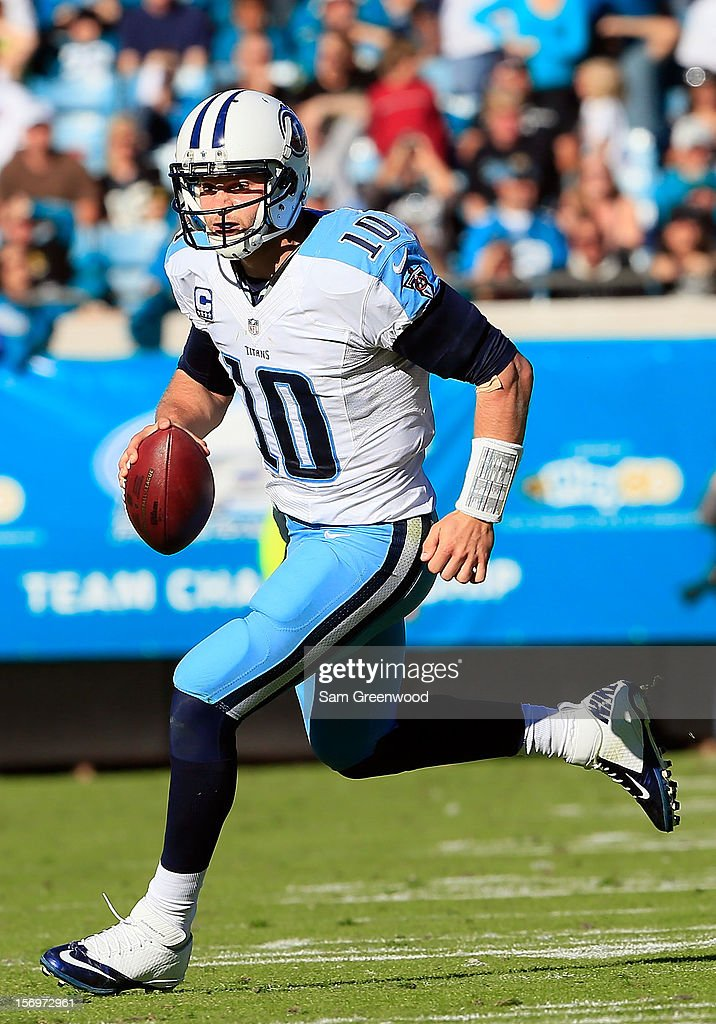 <a gi-track='captionPersonalityLinkClicked' href=/galleries/search?phrase=Jake+Locker&family=editorial&specificpeople=4450185 ng-click='$event.stopPropagation()'>Jake Locker</a> #10 of the Tennessee Titans scrambles for yardage during the game against the Jacksonville Jaguars at EverBank Field on November 25, 2012 in Jacksonville, Florida.