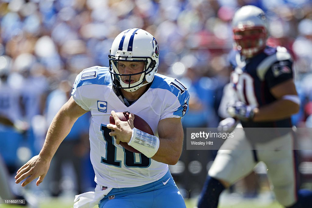 <a gi-track='captionPersonalityLinkClicked' href=/galleries/search?phrase=Jake+Locker&family=editorial&specificpeople=4450185 ng-click='$event.stopPropagation()'>Jake Locker</a> #10 of the Tennessee Titans scrambles with the ball during the season opener against the New England Patriots at LP Field on September 8, 2012 in Nashville, Tennessee. The Patriots defeated the Titans 34 to 13.