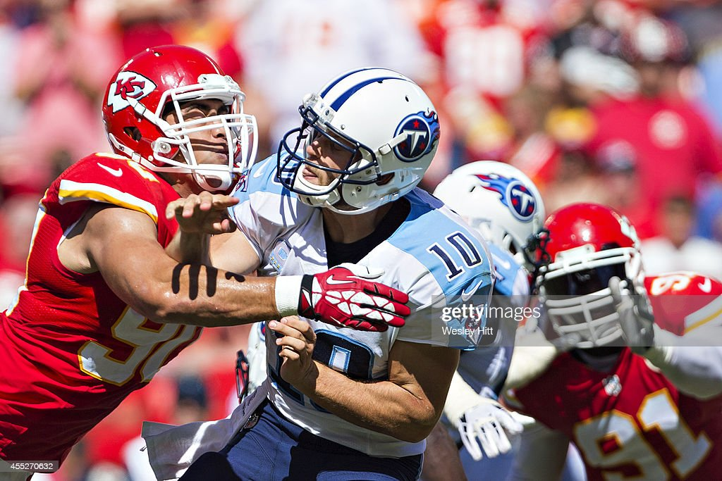 <a gi-track='captionPersonalityLinkClicked' href=/galleries/search?phrase=Jake+Locker&family=editorial&specificpeople=4450185 ng-click='$event.stopPropagation()'>Jake Locker</a> #10 of the Tennessee Titans throws a pass under pressure from <a gi-track='captionPersonalityLinkClicked' href=/galleries/search?phrase=Ropati+Pitoitua&family=editorial&specificpeople=3955458 ng-click='$event.stopPropagation()'>Ropati Pitoitua</a> #92 of the Kansas City Chiefs at Arrowhead Stadium on September 7, 2014 in Kansas City, Missouri. The Titans defeated the Chiefs 26-10.