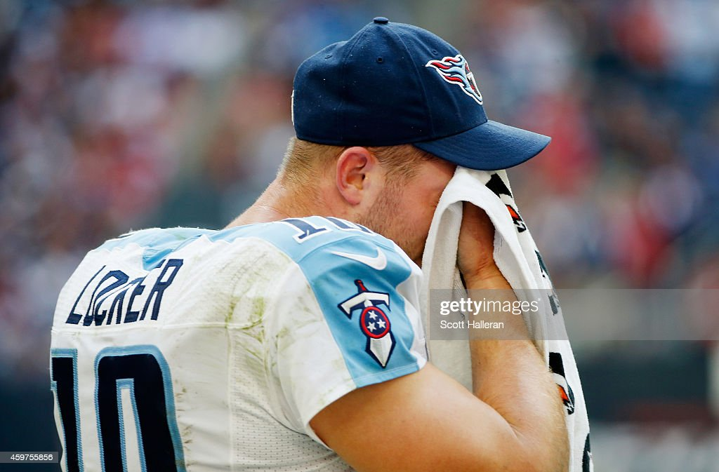 <a gi-track='captionPersonalityLinkClicked' href=/galleries/search?phrase=Jake+Locker&family=editorial&specificpeople=4450185 ng-click='$event.stopPropagation()'>Jake Locker</a> #10 of the Tennessee Titans waits on the sidelines in the second half of their game against the Houston Texans at NRG Stadium on November 30, 2014 in Houston, Texas.