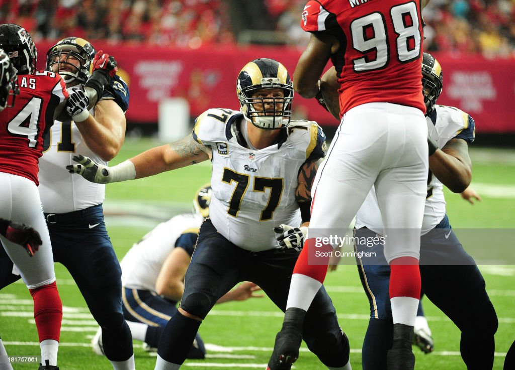 <a gi-track='captionPersonalityLinkClicked' href=/galleries/search?phrase=Jake+Long+-+American+Football+Player&family=editorial&specificpeople=15155386 ng-click='$event.stopPropagation()'>Jake Long</a> #77 of the St. Louis Rams blocks against <a gi-track='captionPersonalityLinkClicked' href=/galleries/search?phrase=Cliff+Matthews&family=editorial&specificpeople=5507696 ng-click='$event.stopPropagation()'>Cliff Matthews</a> #98 of the Atlanta Falcons at the Georgia Dome on September 15, 2013 in Atlanta, Georgia.