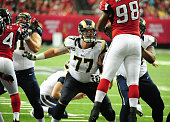 Jake Long of the St Louis Rams blocks against Cliff Matthews of the Atlanta Falcons at the Georgia Dome on September 15 2013 in Atlanta Georgia