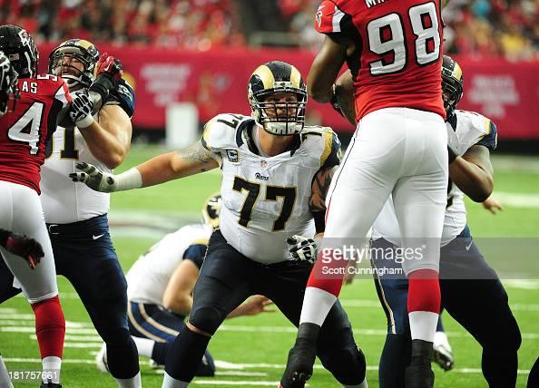 Jake Long of the St Louis Rams blocks against Cliff Matthews of the Atlanta Falcons at the Georgia Dome on September 15 2013 in Atlanta Georgia