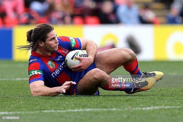 Jake Mamo of the Knights catches the ball during the round 19 NRL match between the Newcastle Knights and the Melbourne Storm at Hunter Stadium on...