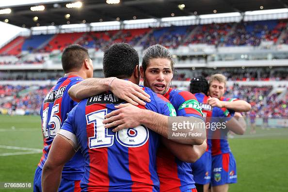 Jake Mamo of the Knights celebrates his try with team mates during the round 19 NRL match between the Newcastle Knights and the Melbourne Storm at...