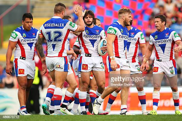 Jake Mamo of the Knights celebrates with team mates after scoring a try during the round 26 NRL match between the Penrith Panthers and the Newcastle...
