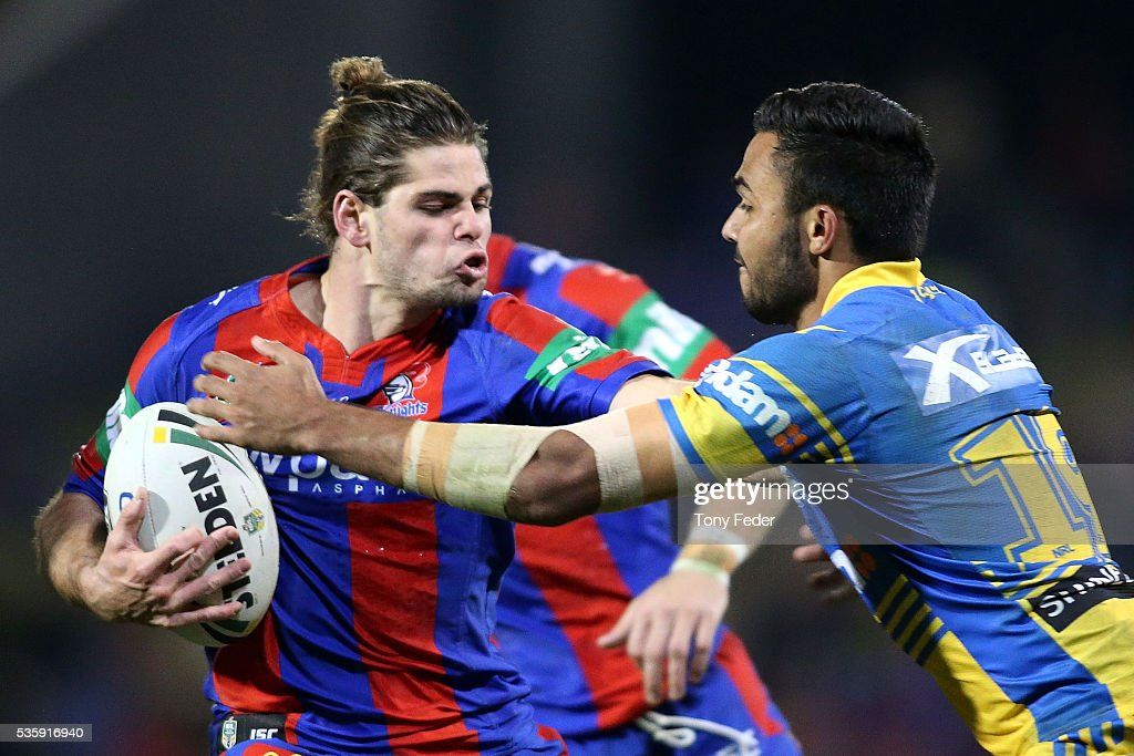 Jake Mamo of the Knights is tackled by Bevan French of the Eels during the round 12 NRL match between the Newcastle Knights and the Parramatta Eels at Hunter Stadium on May 30, 2016 in Newcastle, Australia.