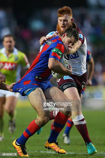 Jake Mamo of the Knights is tackled by Nathan Green of the Sea Eagles during the round 21 NRL match between the Manly Sea Eagles and the Newcastle...