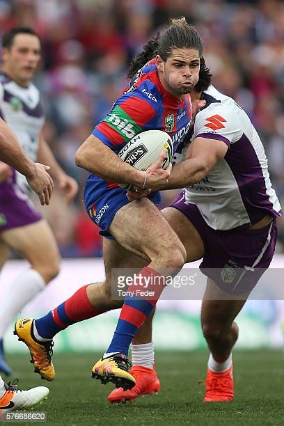 Jake Mamo of the Knights is tackled during the round 19 NRL match between the Newcastle Knights and the Melbourne Storm at Hunter Stadium on July 17...