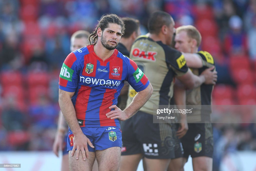 Jake Mamo of the Knights looks dejected as the Panthers celebrate a try during the round 23 NRL match between the Newcastle Knights and the Penrith Panthers at Hunter Stadium on August 14, 2016 in Newcastle, Australia.