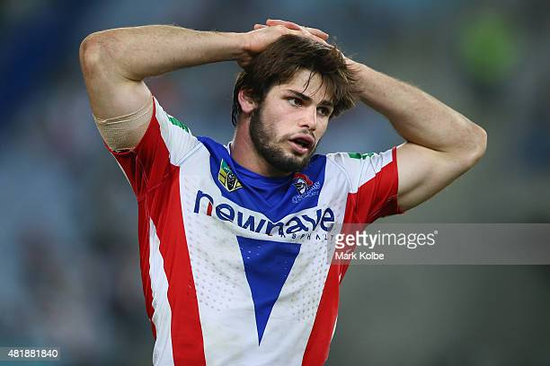 Jake Mamo of the Knights looks dejected during the round 20 NRL match between the South Sydney Rabbitohs and the Newcastle Knights at ANZ Stadium on...