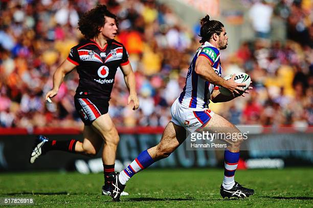 Jake Mamo of the Knights makes a break during the round four NRL match between the New Zealand Warriors and the Newcastle Knights at Mt Smart Stadium...