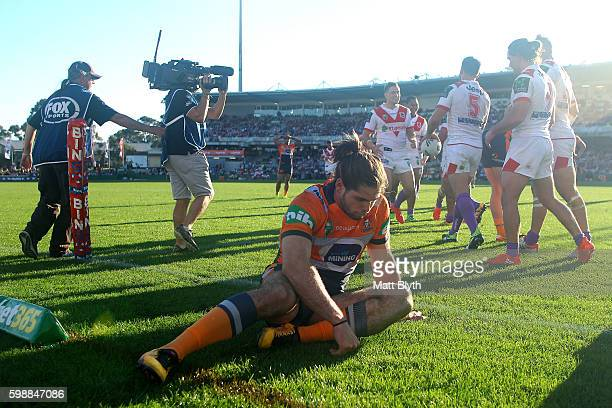 Jake Mamo of the Knights reacts after a Dragons try during the round 26 NRL match between the St George Illawarra Dragons and the Newcastle Knights...