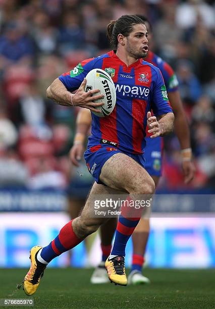 Jake Mamo of the Knights runs the ball during the round 19 NRL match between the Newcastle Knights and the Melbourne Storm at Hunter Stadium on July...