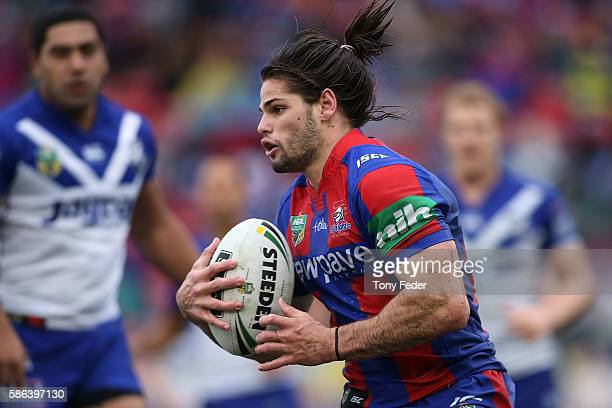 Jake Mamo of the Knights runs the ball during the round 22 NRL match between the Newcastle Knights and the Canterbury Bulldogs at Hunter Stadium on...