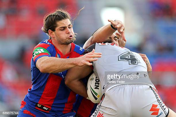 Jake Mamo of the Knights tackles Solomone Katat of the Warriors during the round 14 NRL match between the Newcastle Knights and the New Zealand...