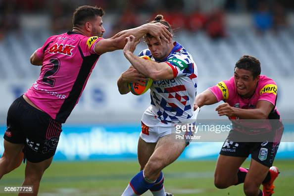 Jake Mamo of the Newcastle Knights is tackled during the 2016 Auckland Nines match between the Newcastle Knights and the Penrith Panthers at Eden...
