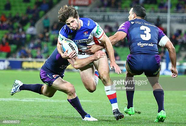 Jake Mamo of the Newcastle Knights is tackled during the round 24 NRL match between the Melbourne Storm and the Newcastle Knights at AAMI Park on...