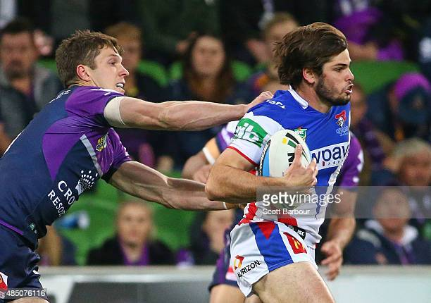 Jake Mamo of the Newcastle Knights runs with the ball during the round 24 NRL match between the Melbourne Storm and the Newcastle Knights at AAMI...