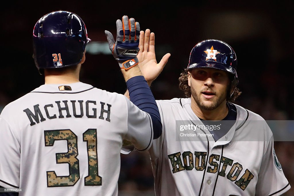 <a gi-track='captionPersonalityLinkClicked' href=/galleries/search?phrase=Jake+Marisnick&family=editorial&specificpeople=10507748 ng-click='$event.stopPropagation()'>Jake Marisnick</a> #6 of the Houston Astros high-fives <a gi-track='captionPersonalityLinkClicked' href=/galleries/search?phrase=Collin+McHugh&family=editorial&specificpeople=9660247 ng-click='$event.stopPropagation()'>Collin McHugh</a> #31 after Marisnick scored a run against the Arizona Diamondbacks during the third inning of the MLB game at Chase Field on May 30, 2016 in Phoenix, Arizona.