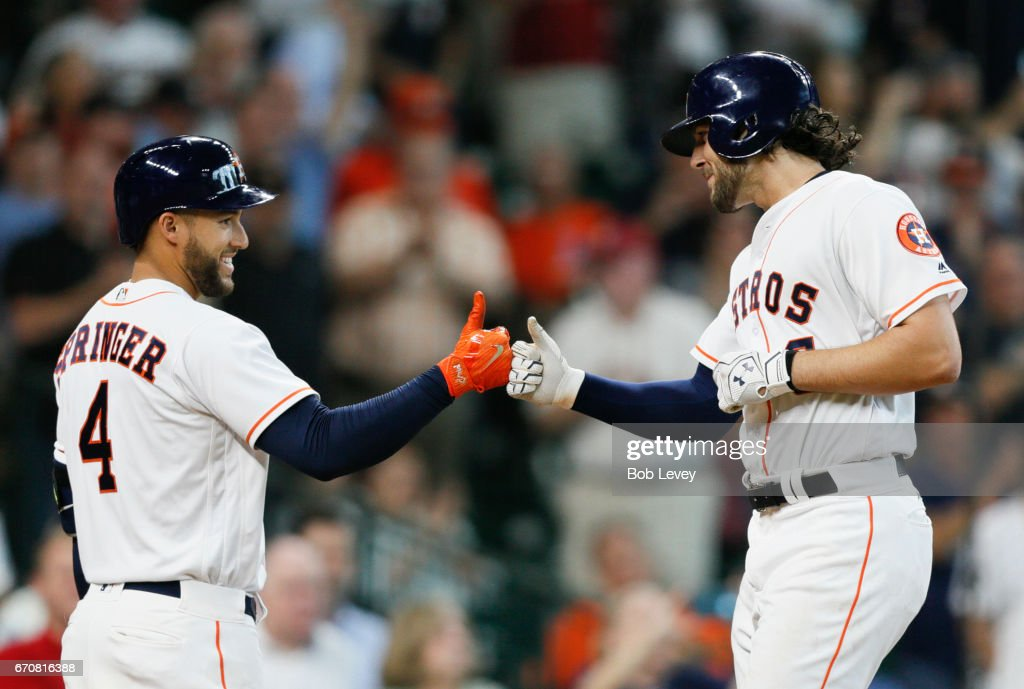 Jake Marisnick #6 of the Houston Astros is congraturlated by George Springer #4 of the Houston Astros after hitting a home run in the fifth inning against the Los Angeles Angels of Anaheim at Minute Maid Park on April 20, 2017 in Houston, Texas.