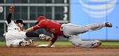 Jake Marisnick of the Houston Astros is tagged out by Andrelton Simmons of the Los Angeles Angels of Anaheim while attempting to steal second during...