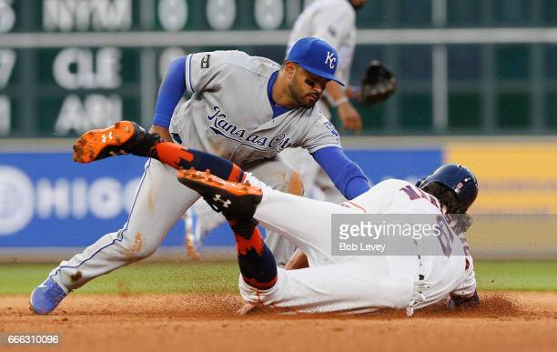 Jake Marisnick of the Houston Astros is tagged out by Christian Colon of the Kansas City Royals in the fifth inning at Minute Maid Park on April 8...