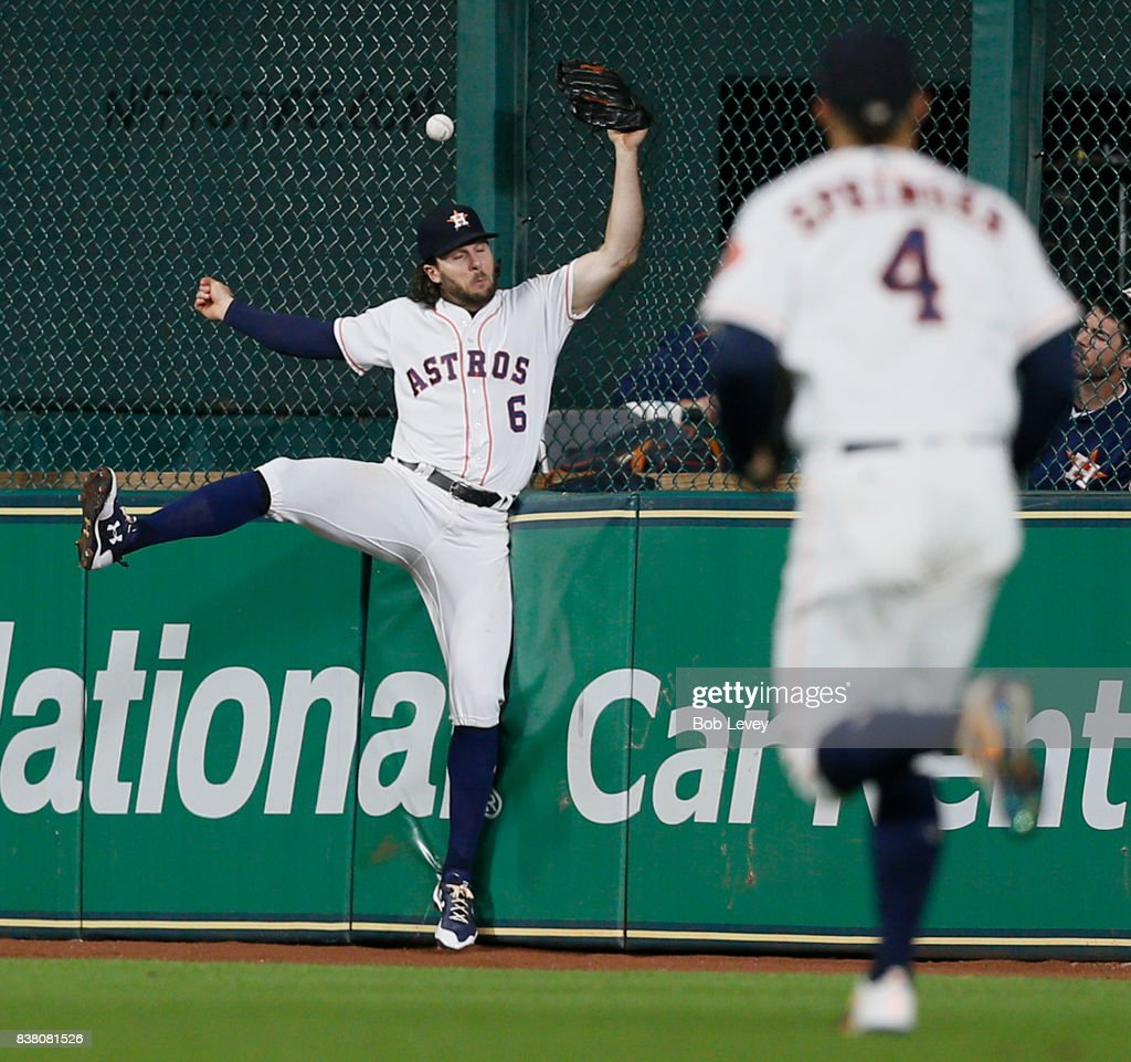 Jake Marisnick #6 of the Houston Astros leaps at the wall but is unable to make the catch on a fly ball off the bat of Howie Kendrick of the Washington Nationals in the eighth inning at Minute Maid Park on August 23, 2017 in Houston, Texas.