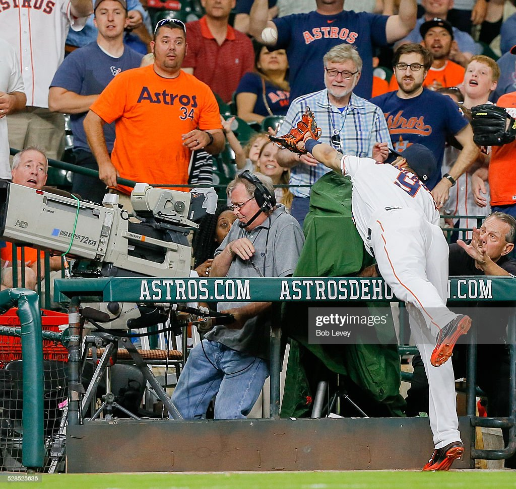 <a gi-track='captionPersonalityLinkClicked' href=/galleries/search?phrase=Jake+Marisnick&family=editorial&specificpeople=10507748 ng-click='$event.stopPropagation()'>Jake Marisnick</a> #6 of the Houston Astros reaches into the stands but comes up short on a foull ball against the Seattle Mariners on May 05, 2016 in Houston, Texas.