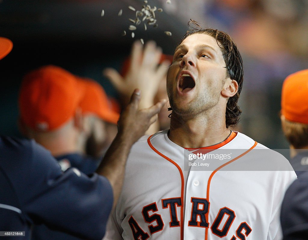 Jake Marisnick #6 of the Houston Astros receives congratulations after scoring in the third inning against the Toronto Blue Jays at Minute Maid Park on August 3, 2014 in Houston, Texas.