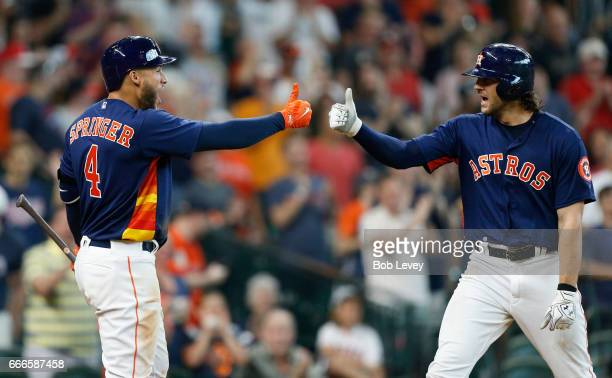 Jake Marisnick of the Houston Astros right celebrates with George Springer after hitting a home run in the ninth inning against the Kansas City...