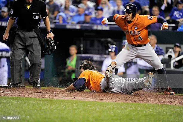 Jake Marisnick of the Houston Astros scores a run on an RBI single hit by Jose Altuve of the Houston Astros in the second inning during game one of...