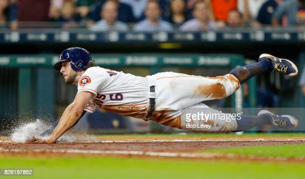 Jake Marisnick of the Houston Astros scores in the fifth inning on a single by Alex Bregman against the Tampa Bay Rays at Minute Maid Park on August...
