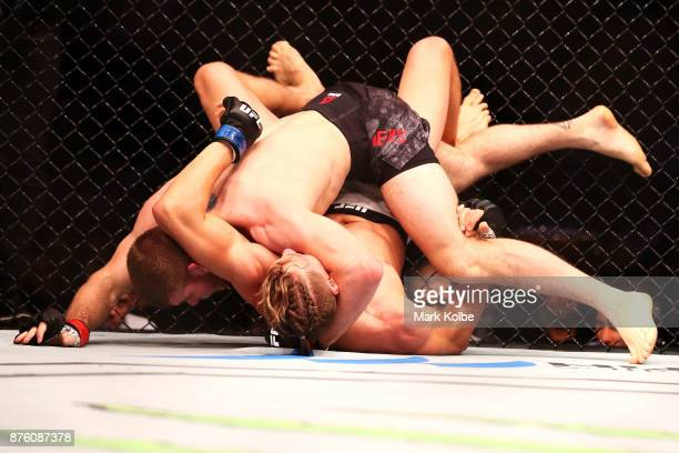 Jake Matthews of Australia and Bojan Velickovic of Serbia wrestle in their welterweight bout during the UFC Fight Night at Qudos Bank Arena on...