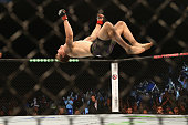 Jake Matthews of Australia celebrates victory over Vagner Rocha with a backflip in their lightweight fight during the UFC Fight Night 55 event at...