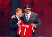 Jake Matthews of the Texas AM Aggies poses with NFL Commissioner Roger Goodell after he was picked overall by the Atlanta Falcons during the first...