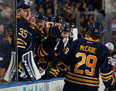 Jake McCabe of the Buffalo Sabres celebrates his goal against the Anaheim Ducks with teammates along the bench including Linus Ullmark at First...