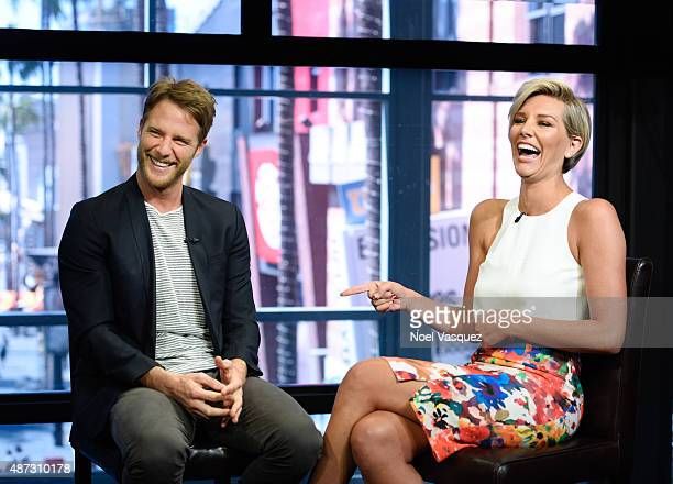 Jake McDorman and Charissa Thompson visit 'Extra' at Universal Studios Hollywood on September 8 2015 in Universal City California