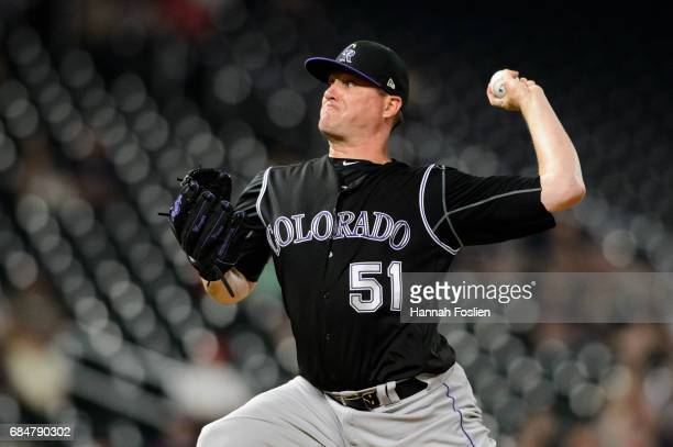 Jake McGee of the Colorado Rockies delivers a pitch against the Minnesota Twins during the game on May 16 2017 at Target Field in Minneapolis...