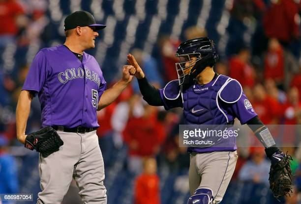 Jake McGee of the Colorado Rockies is congratulated by catcher Tony Wolters after getting the final out in the ninth inning and defeating the...