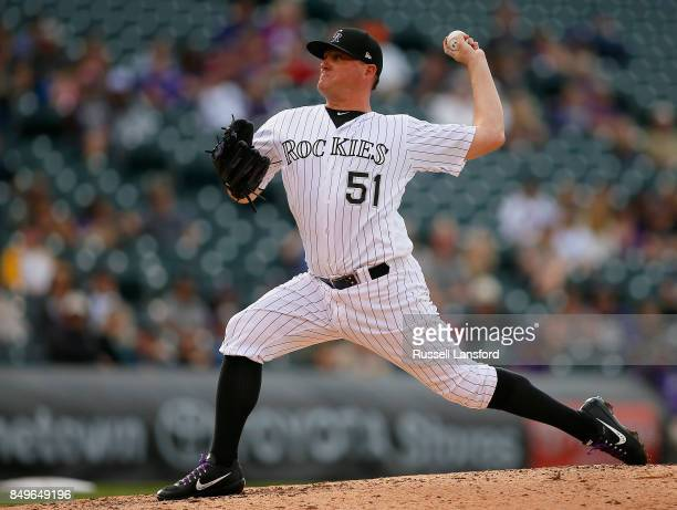 Jake McGee of the Colorado Rockies pitches during a regular season MLB game between the Colorado Rockies and the visiting San Diego Padres at Coors...