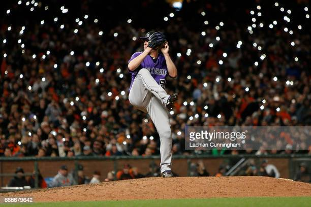 Jake McGee of the Colorado Rockies pitches in the seventh inning against the San Francisco Giants at ATT Park on April 14 2017 in San Francisco...