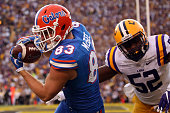 Jake McGee of the Florida Gators scores a touchdown catch over Kendell Beckwith of the LSU Tigers at Tiger Stadium on October 17 2015 in Baton Rouge...