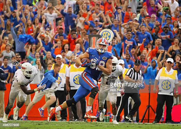 Jake McGee of the Florida Gators scores the gamewinning touchdown during overtime in the game against the Florida Atlantic Owls at Ben Hill Griffin...