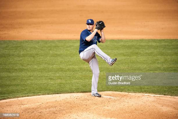 Jake McGee of the Tampa Bay Rays pitches against the Colorado Rockies in the eighth inning of a game at Coors Field on May 3 2013 in Denver Colorado...